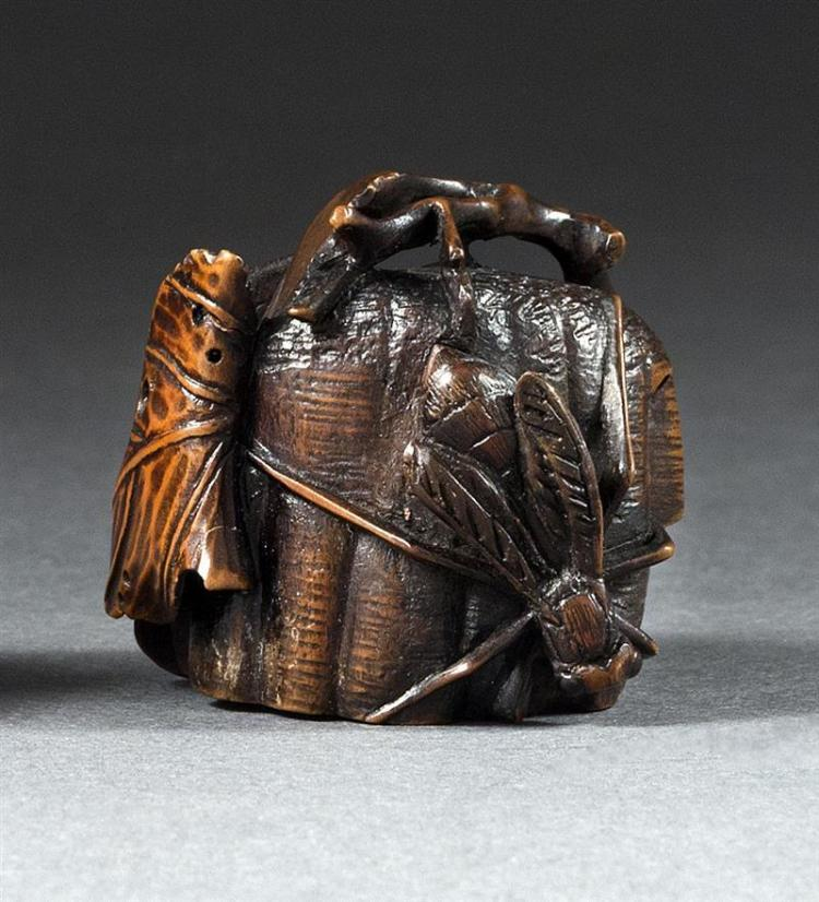 WOOD NETSUKE By Toyomasa. In the form of a wasp and wasp''s nest with inlays of bone and pewter. Signed. Length 1.3