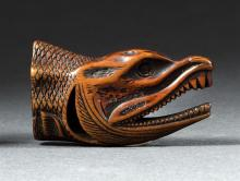 WOOD NETSUKE In the form of a dried fish head. Length 2
