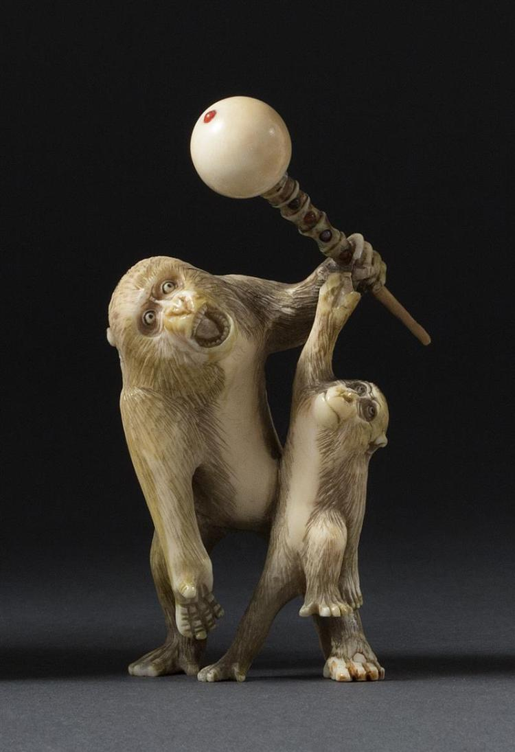 IVORY OKIMONO Depicting two monkeys playing with a baton. Height 3.5