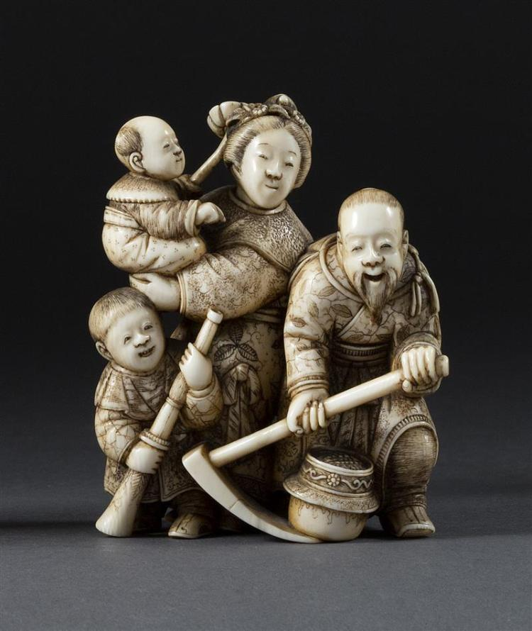 IVORY OKIMONO Depicting a family discovering a pot of gold. Fine details. Signed