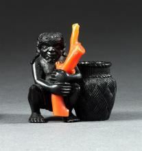 CORAL AND EBONY NETSUKE By Miwa. Depicting a diver with a splintwork basket. Height 1.6