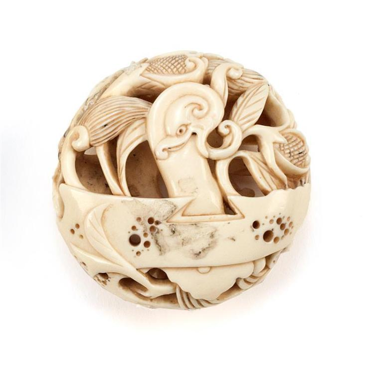 IVORY RYUSAI MANJU With stylized dragon and lotus design. Diameter 1.6