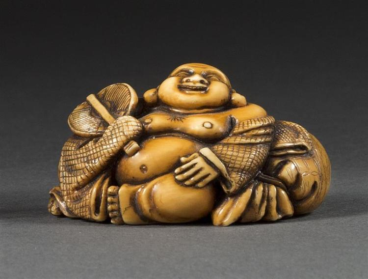 IVORY NETSUKE In the form of Hotei seated with his treasure sack while holding a fan. Signed