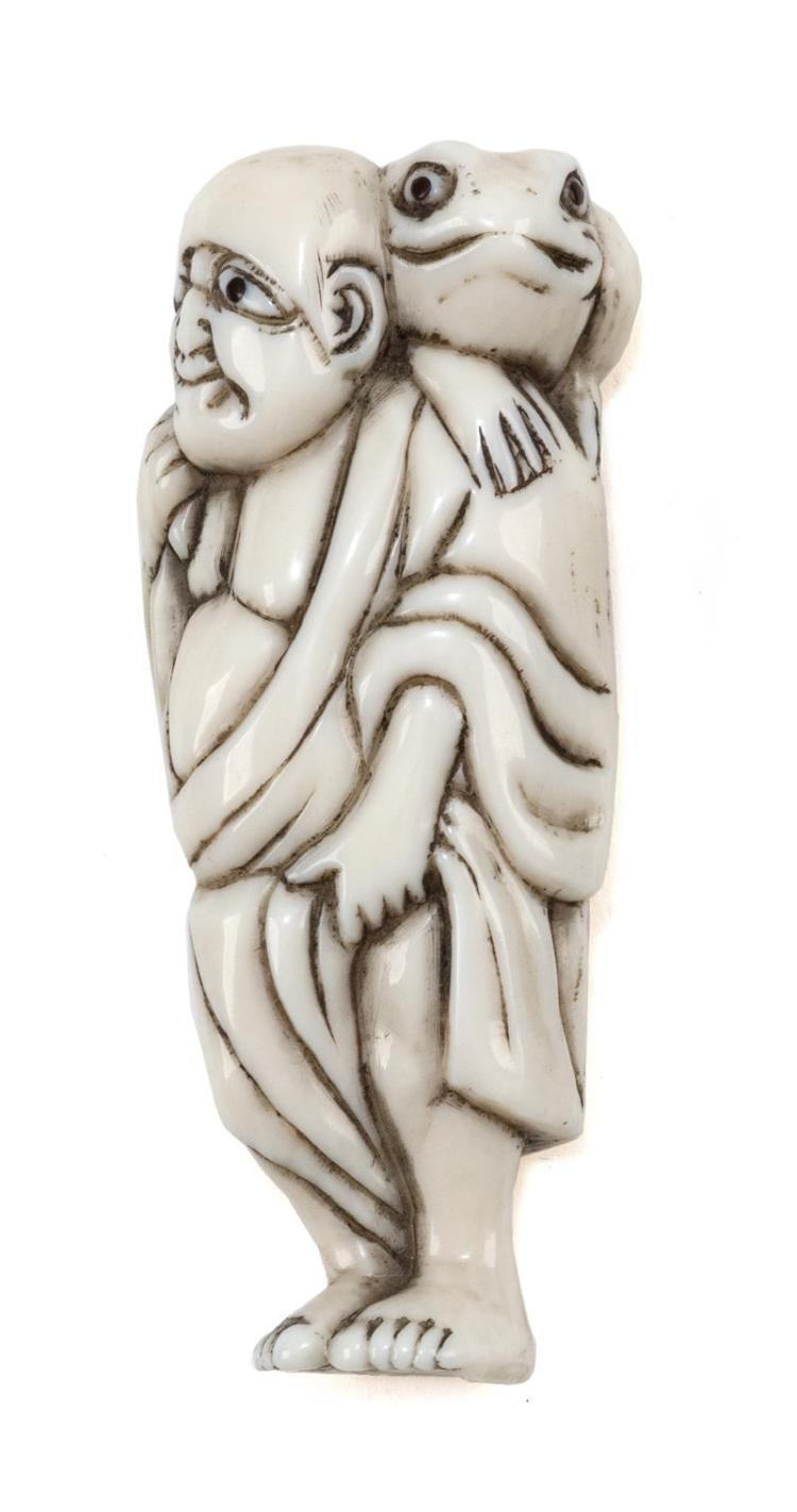 IVORY NETSUKE In the form of Gama Sennin carrying a frog on his shoulder. Height 3