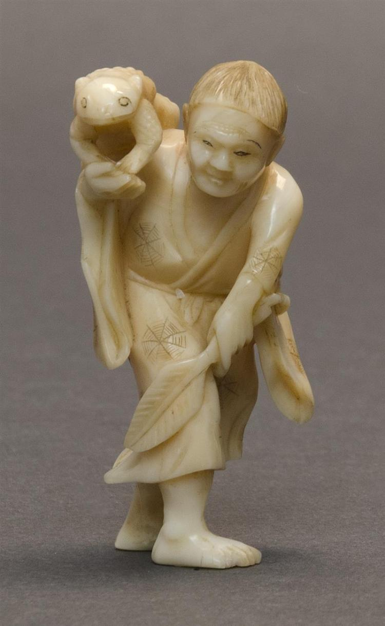 IVORY OKIMONO In the form of Gama Sennin with a frog. Height 2.25
