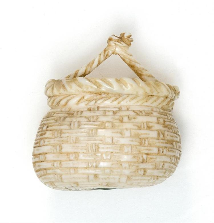 IVORY NETSUKE In the form of a basket of fish. Height 1.2