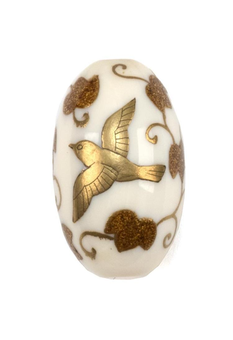 LACQUER-ON-IVORY OJIME With bird and vine design in gold lacquer. Length 1.1