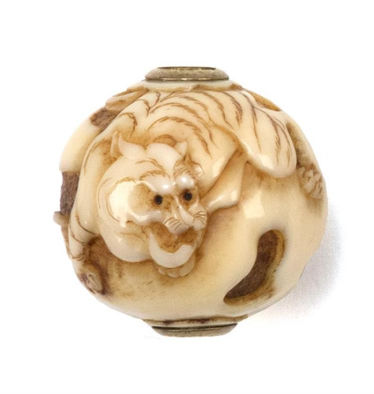 IVORY OJIME In ball form with tiger design. Diameter 1.6