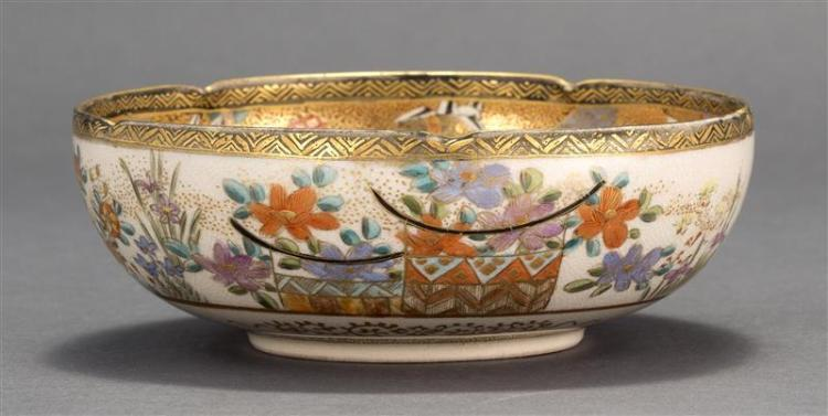 SATSUMA PORCELAIN BOWL With a pinched rim. Interior with heavily gilded patchwork interior and a cartouche of ladies in a landscape...