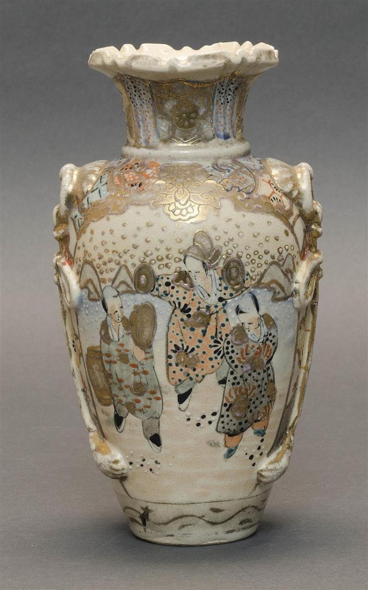 SATSUMA POTTERY VASE In bluster form. With mock tassel handles, flared mouth, and shaped rim. Figural decoration about the body and...