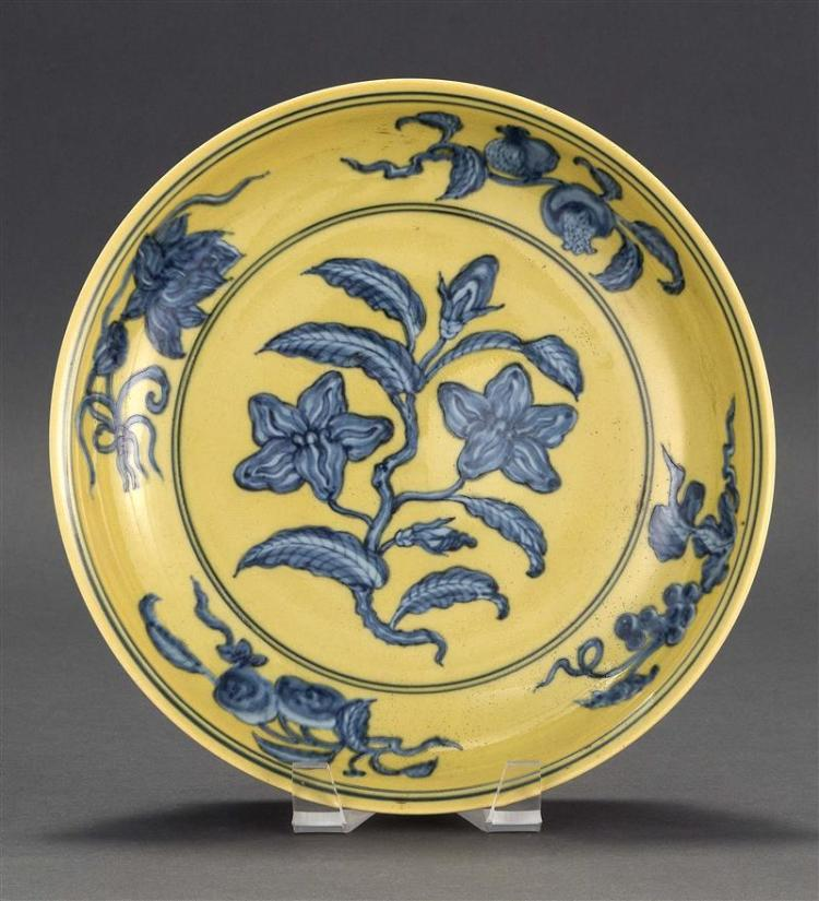 UNDERGLAZE BLUE-ON-YELLOW ENAMEL PORCELAIN DISH With flower, fruit, and vine design. Six-character Ming mark on base. Diameter 10.4