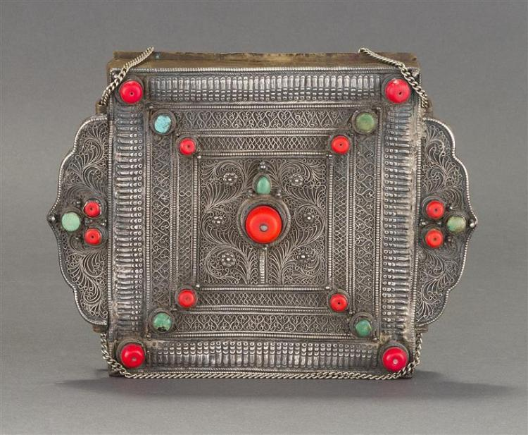 TIBETAN SILVER PRAYER BOX (GAU) In square form with coral and turquoise cabochons on a delicate silver filigree and embossed ground....