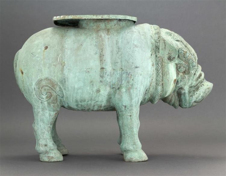 THAI BRONZE GARDEN SEAT In the form of a caparisoned pig. Length 22.5
