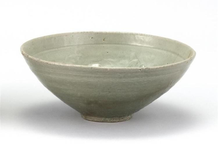 KOREAN CELADON BOWL With carved floral design. Diameter 7.1