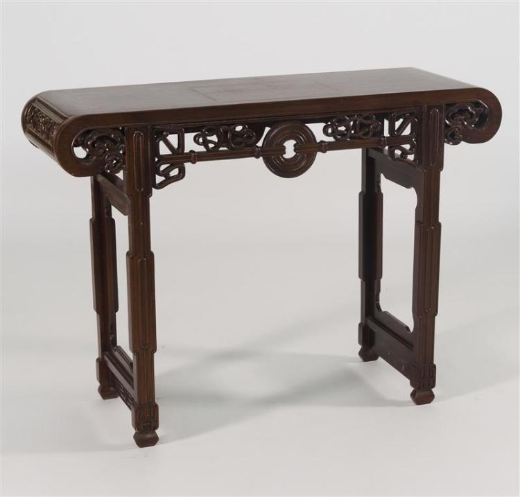 ALTAR TABLE Rectangular top with scrolled ends. Above an openwork apron in coin and ruyi fungus design. Shaped legs. Height 35