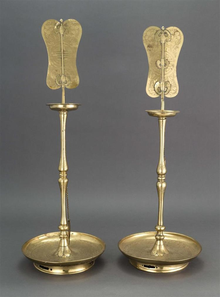 PAIR OF KOREAN BRASS PRICKET CANDLESTICKS With dish-like bases and fan-form reflectors. Heights 30