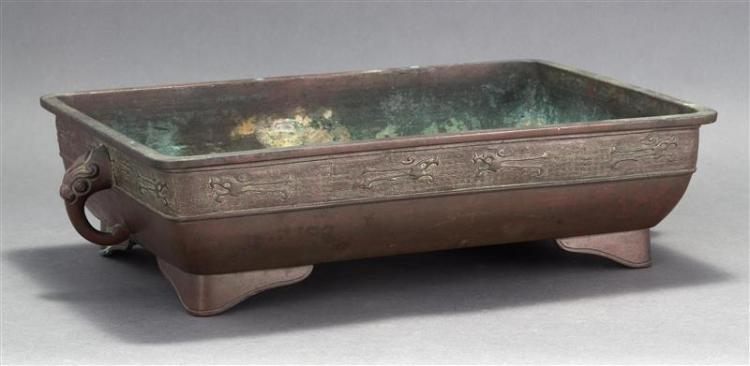 BRONZE PLANTER In rectangular form with dragon and fret design. Animalistic handles. Length 20