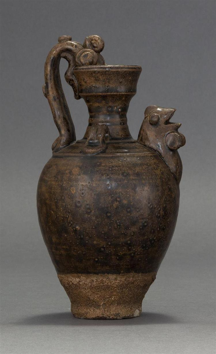 SOUTHEAST ASIAN POTTERY EWER In inverted pear shape with applied dragon-form handle and chicken-head spout. All executed with a blac...