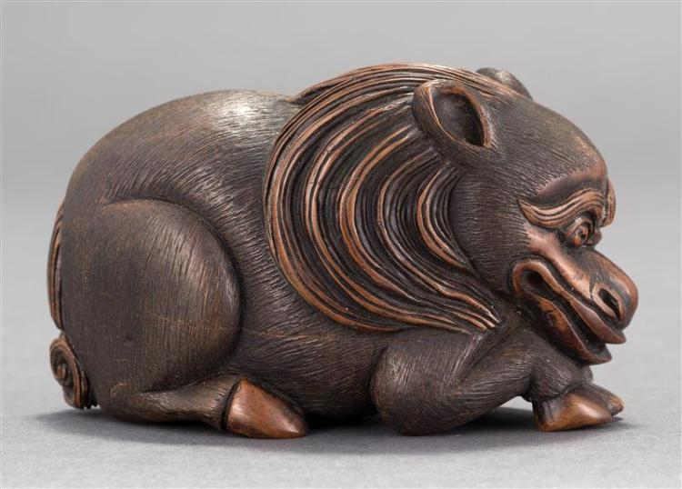 WOOD OKIMONO In the form of a grotesque reclining horse. Length 3.5