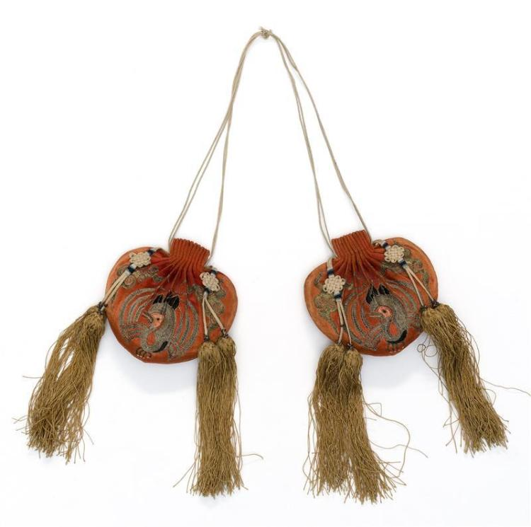 TWO SILK NEEDLEWORK SNUFF BOTTLE CASES With phoenix and cloud design on a salmon ground. Lengths 3.3