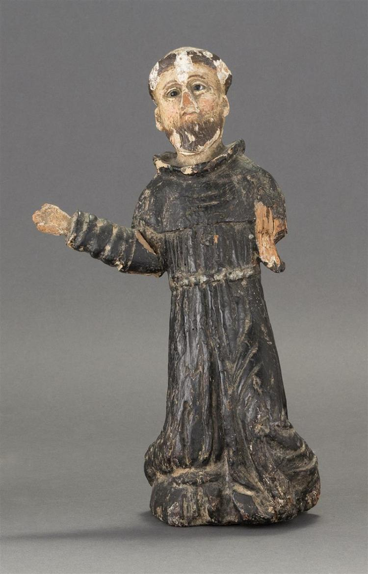 CARVED AND POLYCHROMED WOOD FIGURE Depicting St. Francis in standing position wearing black robes. Glass eyes. Height 12.5