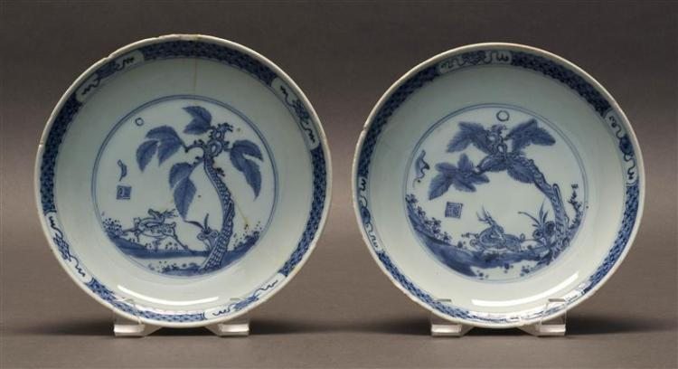 PAIR OF BLUE AND WHITE PORCELAIN PLATES Depicting deer and palm trees. Diameters 8