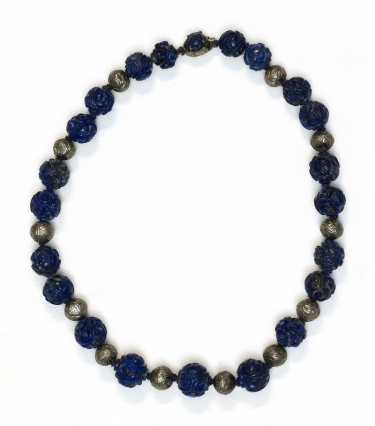 LAPIS LAZULI AND WHITE METAL BEAD NECKLACE With carved lapis lazuli beads. Silver clasp. Length 13.5