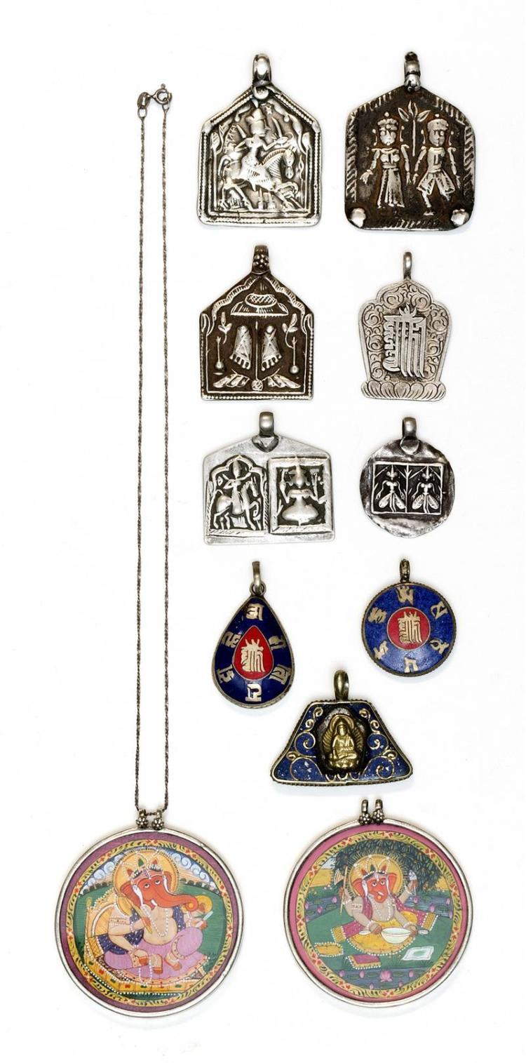COLLECTION OF NINE INDIAN SILVER, ENAMEL, AND PAINTED PENDANTS Two depicting Ganesha and seven of various other deities.