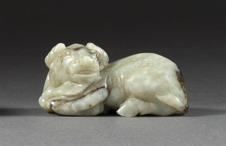GRAY AND BLACK JADE CARVING In the form of a reclining water buffalo. Length 2.5