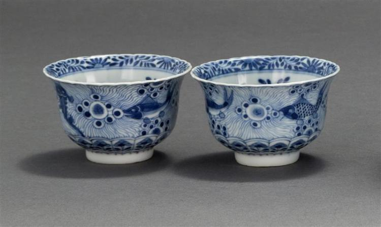 PAIR OF BLUE AND WHITE PORCELAIN TEACUPS In bell form with decoration of sea creatures. Four-character Kangxi mark on base. Diameter...
