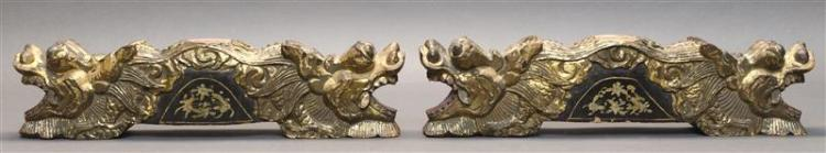 PAIR OF CARVED GILT DRAGONS Most likely a base to a stand. Each piece comprised of double-ended dragons separated by a domed gilt la...