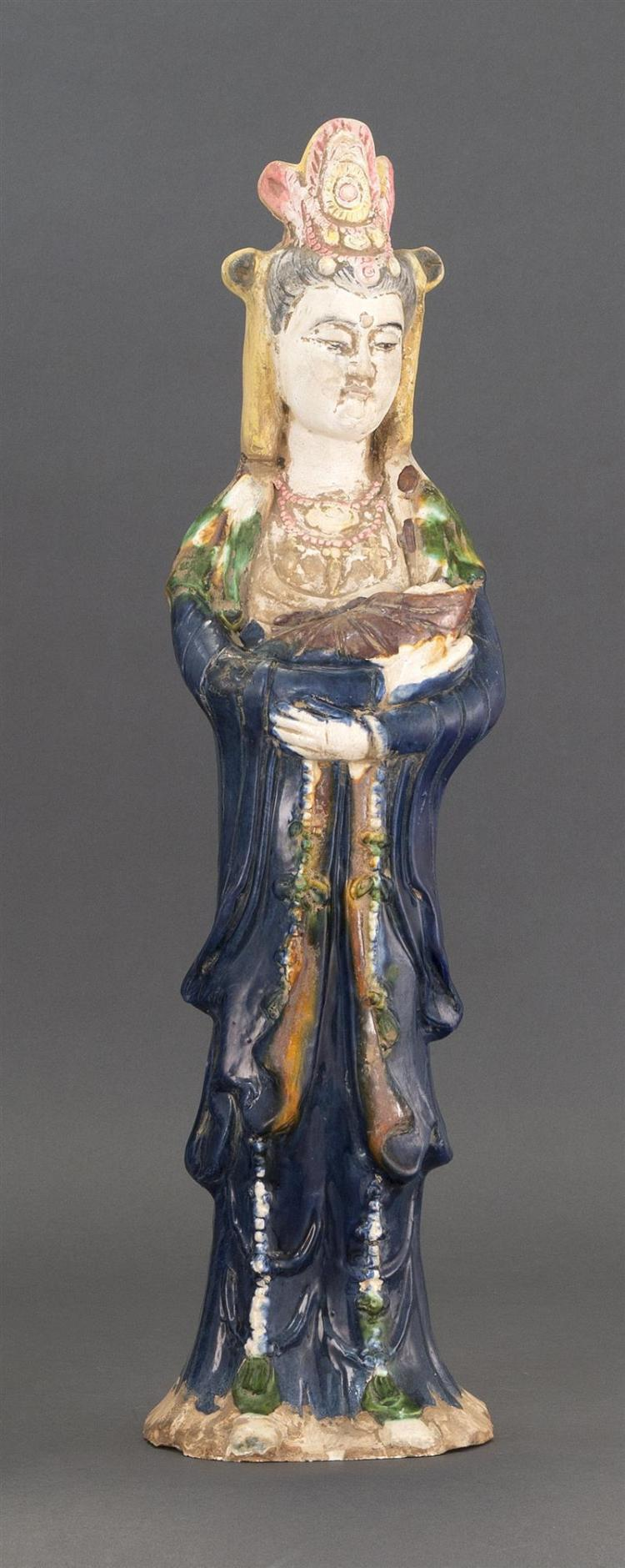 SANCAI PORCELAIN FIGURE OF GUANYIN Dressed in blue robes while cradling an infant. Unglazed from bust up. Height 19.5