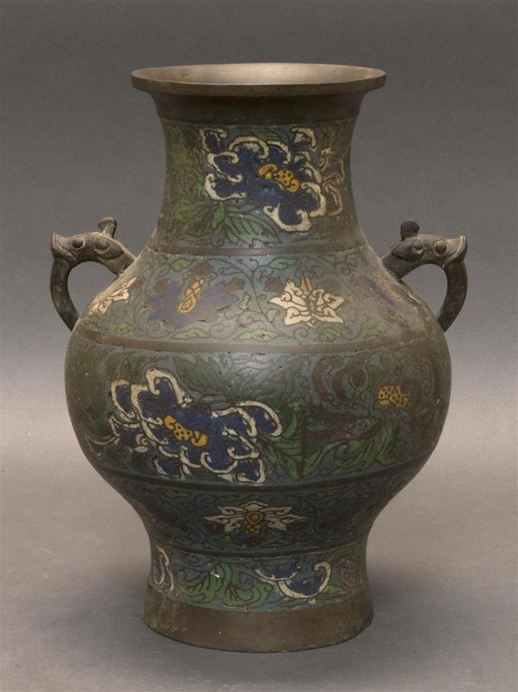 CHAMPLEVÉ ENAMEL VASE With flared mouth and bulbous body on a slightly flared foot. Decorated with allover lotus flowers and leaves...