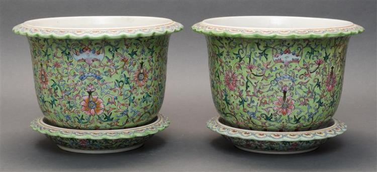 PAIR OF FAMILLE VERTE PORCELAIN JARDINIÈRES AND UNDERTRAYS Both with yellow lappet-decorated petal rims. Bodies decorated with famil...