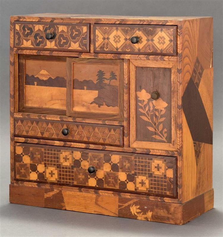 INLAID MARQUETRY KIRIWOOD KITCHEN TANSU-STYLE DRESSER BOX With four drawers, a sliding door with decoration of landscape with Mount...