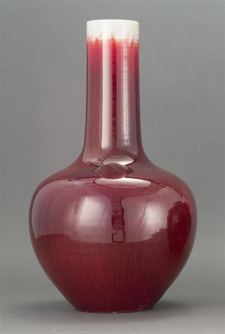 SANG DE BOEUF PORCELAIN VASE In ovoid form with cylindrical neck with shaded red and white glaze. Height 17