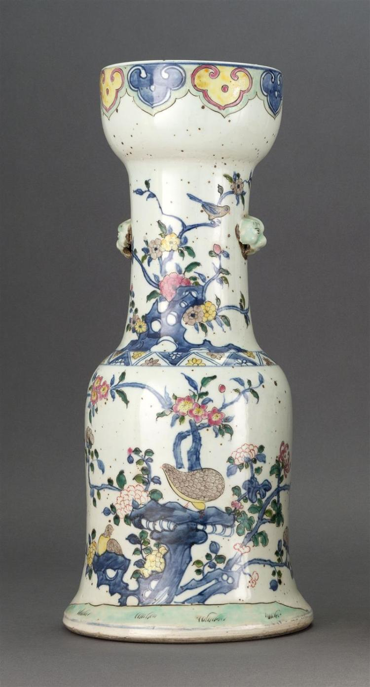UNDERGLAZE BLUE AND ENAMELED PORCELAIN VASE In hourglass form. With lion''s-head handles and decoration of quail and flowers. Double...