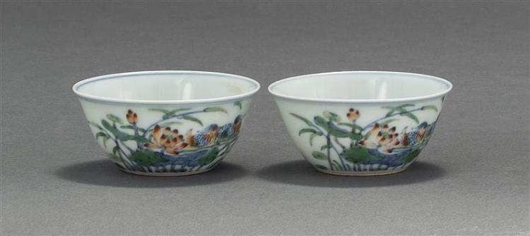 PAIR OF DOUCAI PORCELAIN WINE CUPS Depicting mandarin ducks and lotus. Six-character Yongzheng mark on base. Diameter 3.25