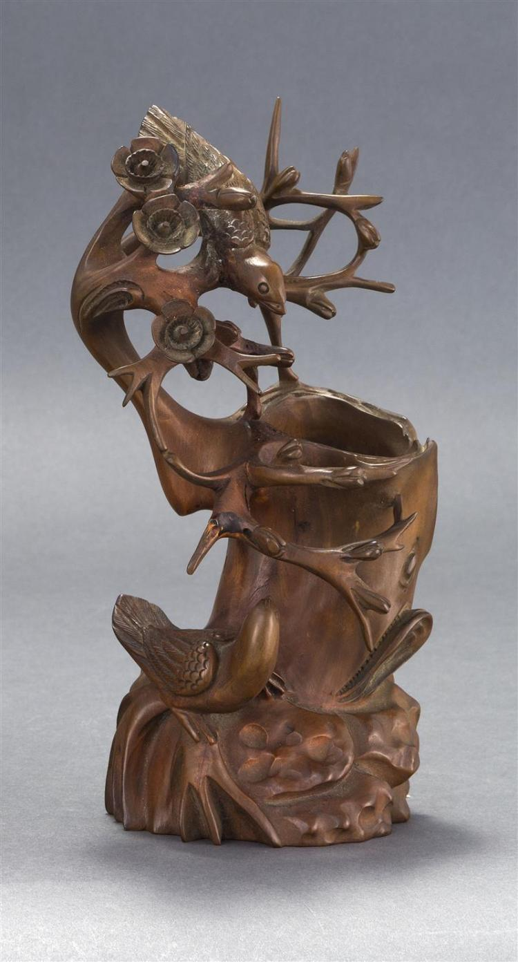 CARVED WOOD VASE With full-relief carving of birds and flowering branches about a hollowed tree stump. Height 10.2