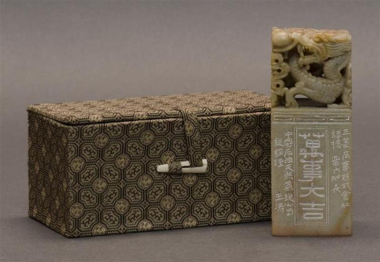 SOAPSTONE SEAL In rectangular form with dragon finial and calligraphic carving. Base cut with four characters. Height 4