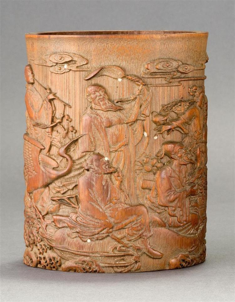 BAMBOO BRUSH POT Finely carved in relief with Immortals in a landscape. Height 6.4