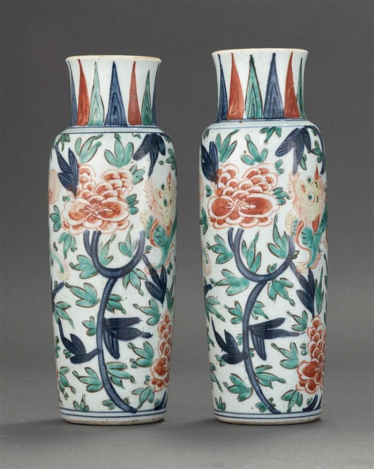 PAIR OF WUCAI PORCELAIN VASES In cylinder form with decoration of lions and peonies. Heights 10.25