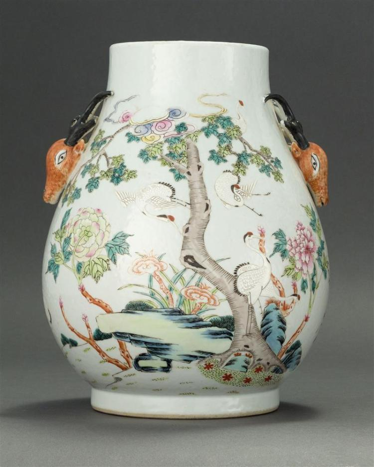 POLYCHROME PORCELAIN VASE In pear shape with deer''s-head handles and decoration of deer and cranes in floral landscapes. Six-charact..