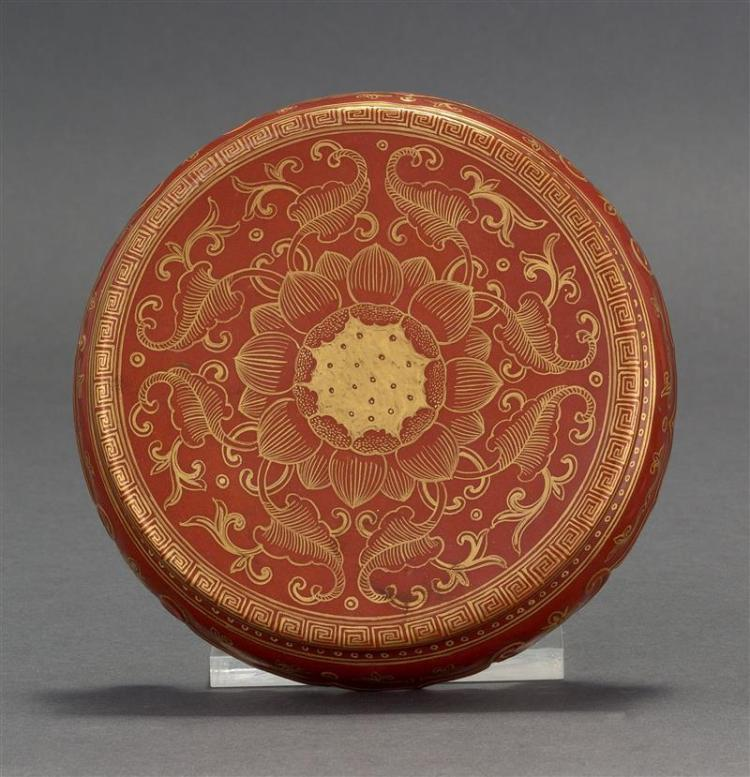 SALMON-RED AND GILT PORCELAIN STAND In circular form with passionflower design. Six-character Qianlong mark on base. Diameter 5