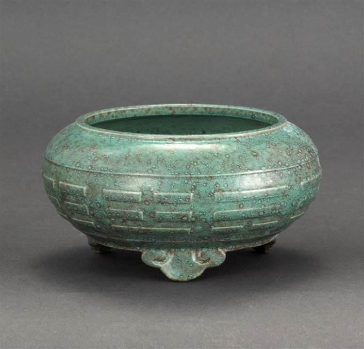 ROBINS'' EGG BLUE PORCELAIN FOOTED CENSER In ovoid form with trigrams design and ruyi-form feet. Six-character Qianlong mark on base...