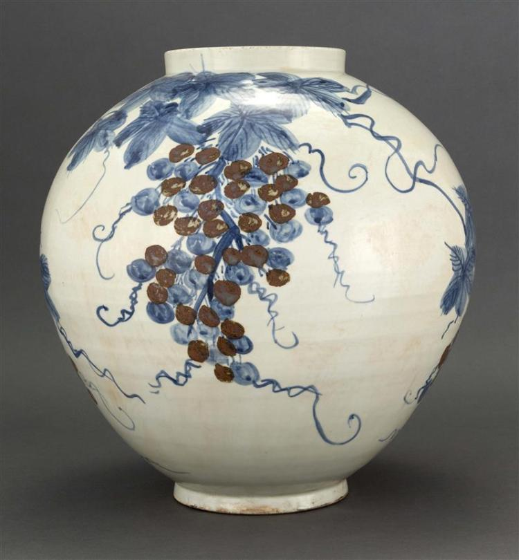 KOREAN UNDERGLAZE RED AND BLUE PORCELAIN JAR In ovoid form with grape and grapevine design. Height 15.2