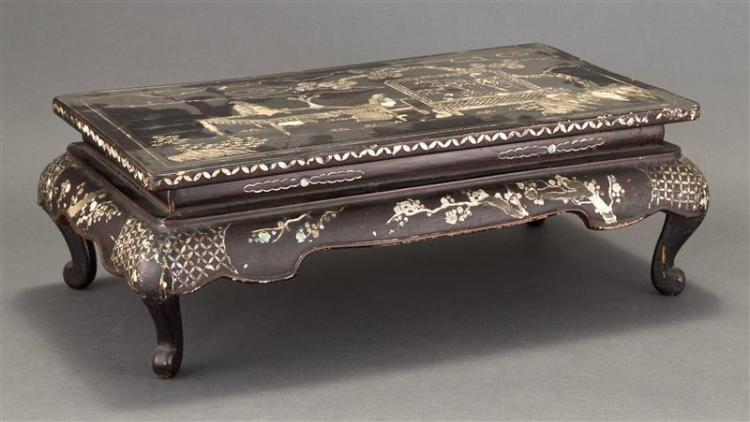 MOTHER-OF-PEARL INLAID BLACK LACQUER STAND In rectangular form with decoration of sages beneath a pine tree. Height 6