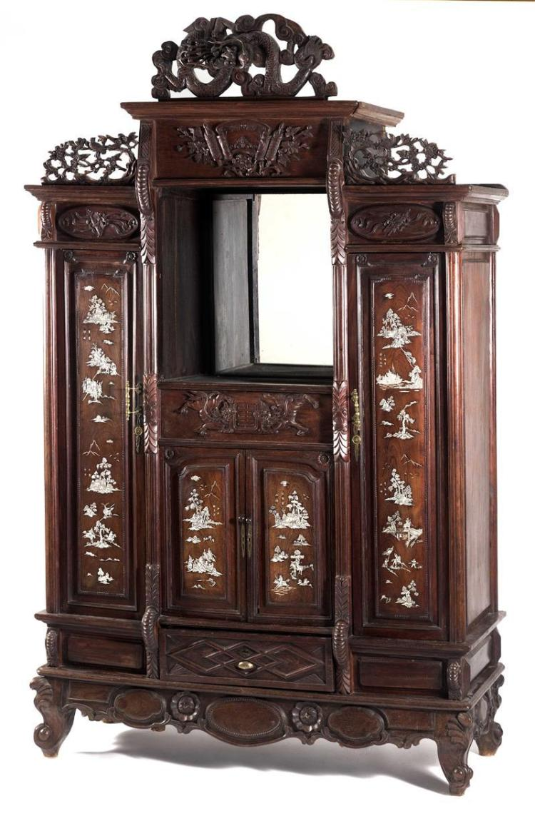 CARVED HONGMU CABINET Openwork carved prunus frieze over a mirrored-back open cabinet, flanked by inlaid doors with figural and land...