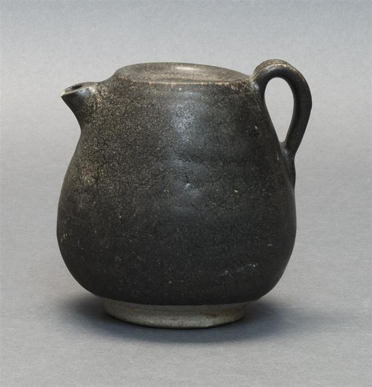 BLACK-BROWN GLAZE STONEWARE EWER In ovoid form with applied handle. Height 4.25