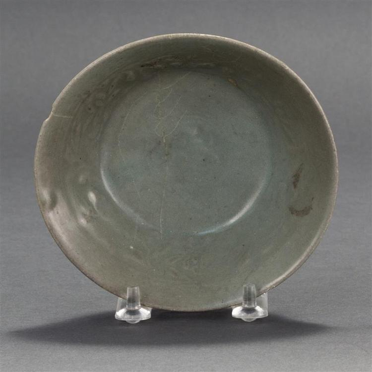 KOREAN CELADON BOWL In conical form with carved lotus design. Diameter 5.5